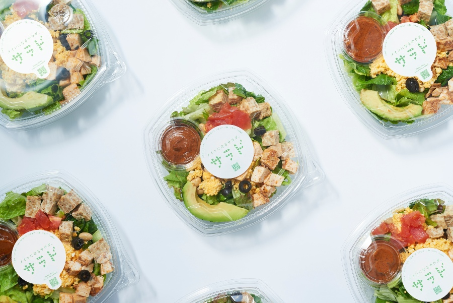 sealed lunch salad boxes with croutons, avocado and dipping sauce