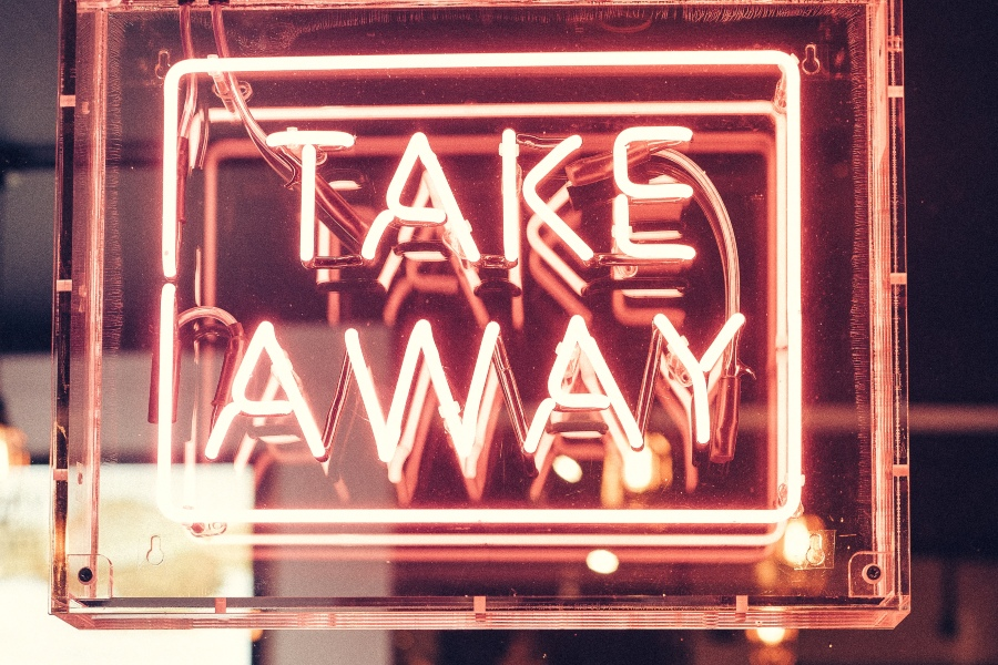 neon sign reading take away in all capital letters
